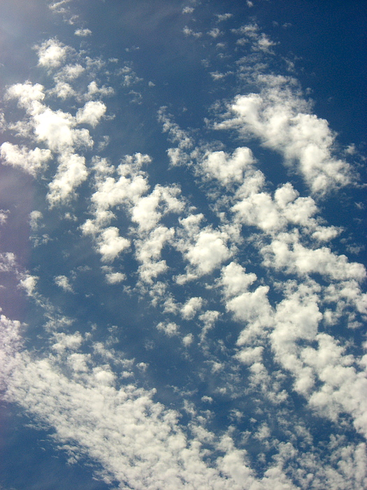 Sky Photograph - Cloud Clusters by Kimberly Morin
