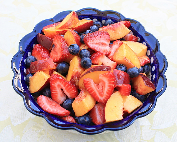 Food And Beverages Photograph - Fruit Salad In Blue Bowl by Carol Groenen