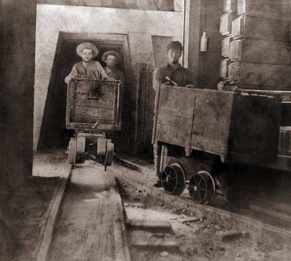 History Photograph - Miners Pushing Ore Carts by Everett