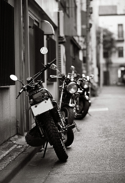 Vertical Photograph - Motorbikes Parked On Street In Tokyo, Japan by photo by Jason Weddington
