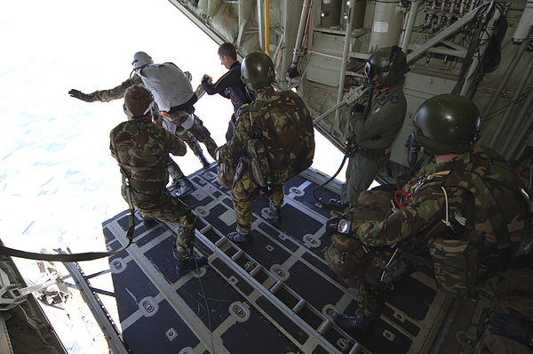 British Army Photograph - Paratroopers Jump From A C-130 Hercules by Andrew Chittock