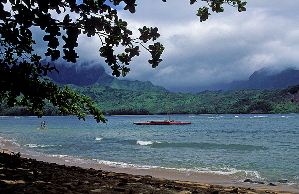 Seascapes Photograph - Red Canoe On Hanalei Bay by Kathy Yates