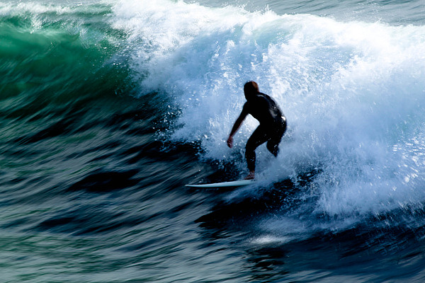 Surfing Photograph - Riding The Waves by Magdalena Green