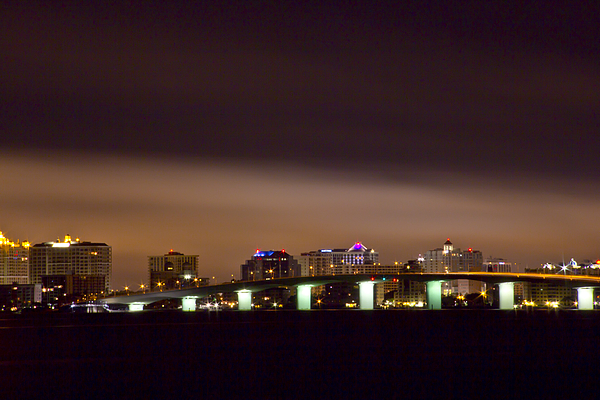The John Ringling Bridge And The Sarasota City With Night Time Clouds Lit Up By The City Lights Architecture  Photograph - Ringling Bridge And Sarasota by Nicholas Evans
