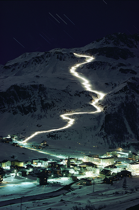 Skiers Bearing Torches Ski Down Mont Photograph
