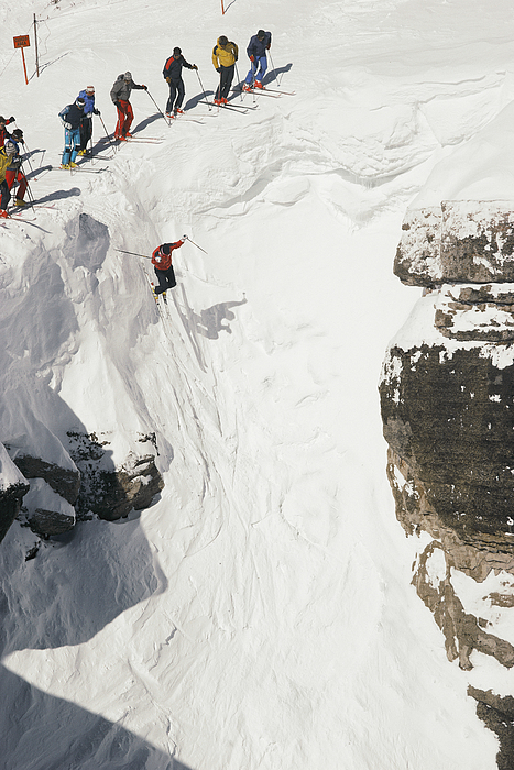Outdoors Photograph - Skilled Skiers Plunge More Than 15 Feet by Raymond Gehman
