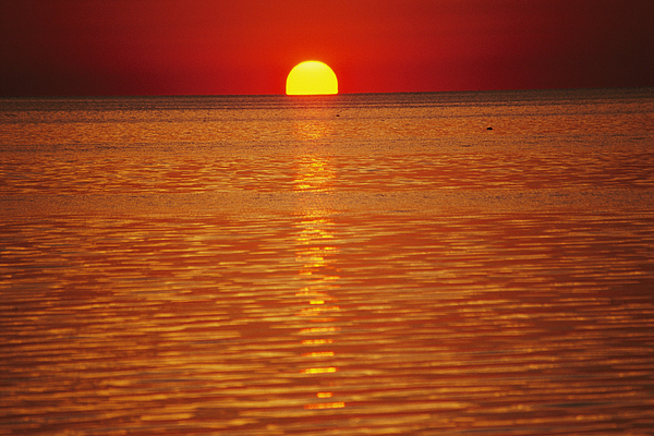 Atlantic Ocean Photograph - The Sun Sinks Into Pamlico Sound Seen by Stephen St. John