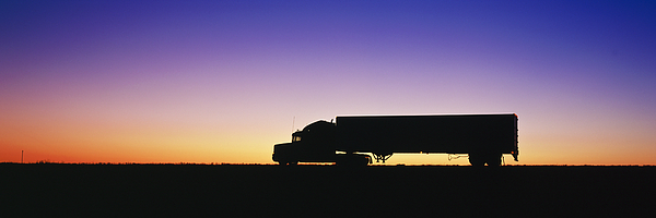 18 Wheeler Photograph - Truck Parked On Freeway At Sunrise by Jeremy Woodhouse
