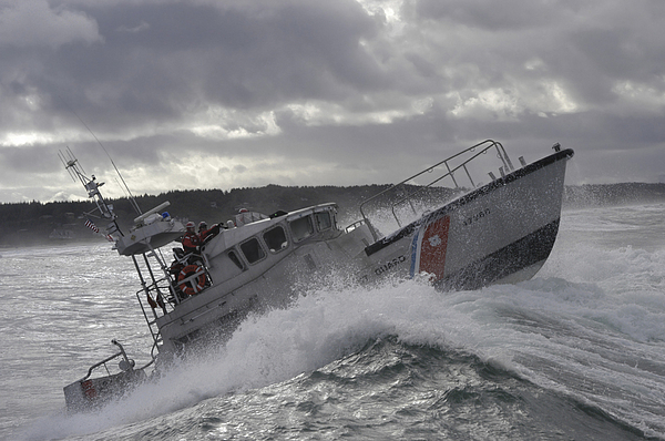 Horizontal Photograph - U.s. Coast Guard Motor Life Boat Brakes by Stocktrek Images