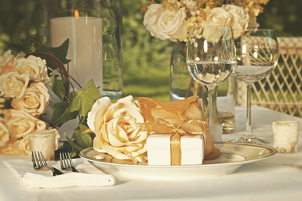 Wedding Party Favors On Plate At Reception Photograph