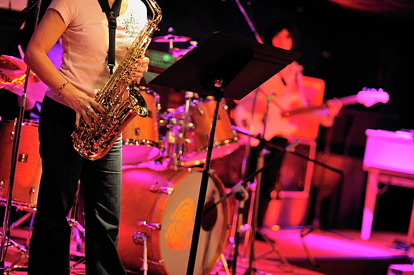 Adult Photograph - Woman Playing Saxophone On Stage With Her Band by Sami Sarkis