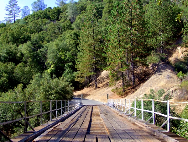 Wood Bridge Photograph - Wooden Bridge Over Deep Gorge by Mary Deal