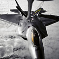 A Kc-135 Stratotanker Refuels A F-22 by Stocktrek Images