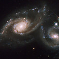 A Triplet Of Galaxies Known As Arp 274 by Stocktrek Images