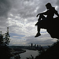 A Woman Perched On An Overlook by Lynn Johnson