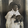 A Young Kenyan Woman Holds Her Pet Deer by Underwood And Underwood