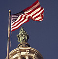An American Flag And The Statue by Medford Taylor
