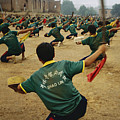 Children Practice Kung Fu In A Field by Justin Guariglia