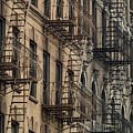 Fire Escapes On Brownstone Apartment by Everett