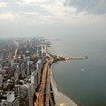 Lake Michigan And Chicago Skyline. by Ixefra