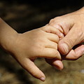 Mother Holding Baby Daughter's Hand by Sami Sarkis