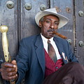 Portrait Of A Man Wearing A 1930s-style Suit And Smoking A Cigar In Havana by Sami Sarkis