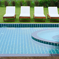 Swimming Pool And Chairs by Atiketta Sangasaeng