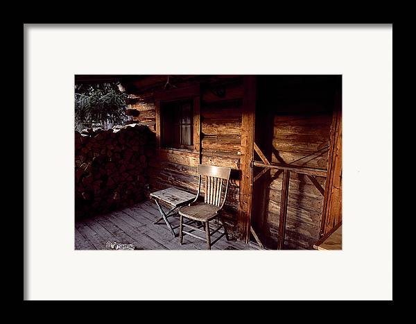 Outdoors Framed Print featuring the photograph Firewood And A Chair On The Porch by Joel Sartore
