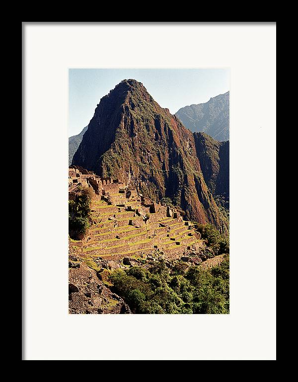 Vertical Framed Print featuring the photograph The Ruins Of Machu Picchu, Peru, Latin America by Brian Caissie