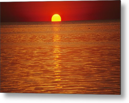 Atlantic Ocean Metal Print featuring the photograph The Sun Sinks Into Pamlico Sound Seen by Stephen St. John