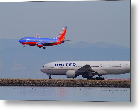 Southwest Metal Print featuring the photograph United Airlines And Southwest Airlines Jet Airplane At San Francisco International Airport Sfo.12087 by Wingsdomain Art and Photography