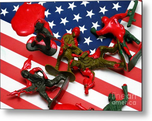 Against The War Metal Print featuring the photograph Fallen Toy Soliders On American Flag by Amy Cicconi