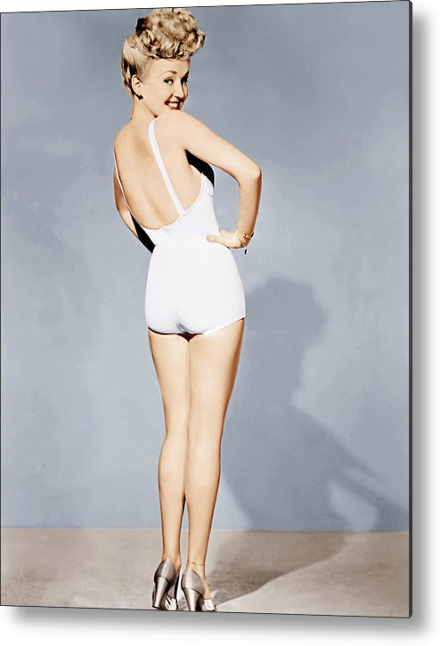 1940s Portraits Metal Print featuring the photograph Betty Grable, World War II Pin-up, 1943 by Everett