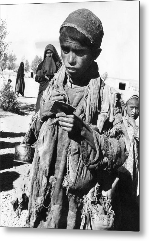 History Metal Print featuring the photograph Afghan Youngster In A Unicef Feeding by Everett