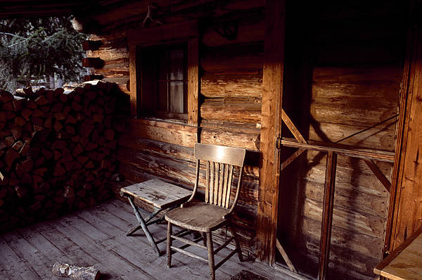 Outdoors Print featuring the photograph Firewood And A Chair On The Porch by Joel Sartore