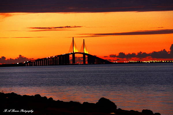 Sunshine Skyway Bridge Print featuring the photograph Sunset Over The Skyway Bridge by Barbara Bowen