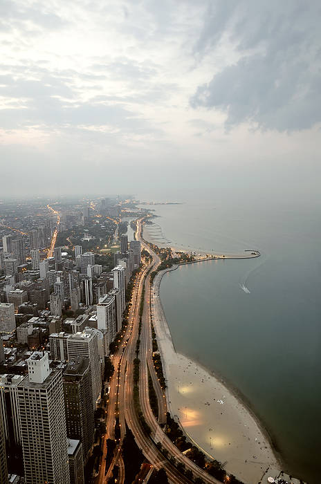 Vertical Print featuring the photograph Lake Michigan And Chicago Skyline. by Ixefra