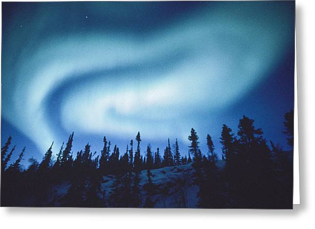 Northwest Territories Greeting Cards - The Aurora Borealis Creates  Swirls Greeting Card by Paul Nicklen
