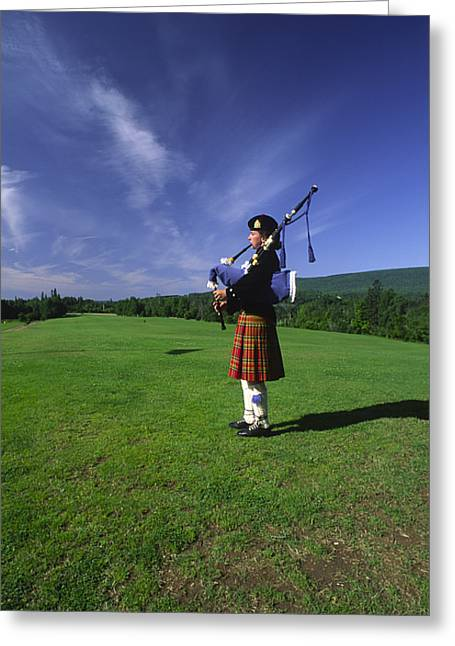 Playing Musical Instruments Greeting Cards - A Bagpiper At A Gaelic Mod Held Greeting Card by Michael Melford