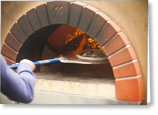 A Woman Puts A Pizza In A Wood Fired Greeting Card by Taylor S. Kennedy