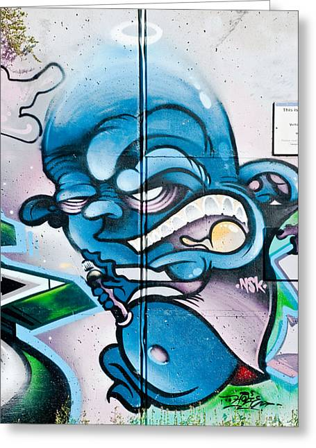 Aerosol Paintings Greeting Cards - Angry Blue Creature with a spray-paint can Greeting Card by Yurix Sardinelly