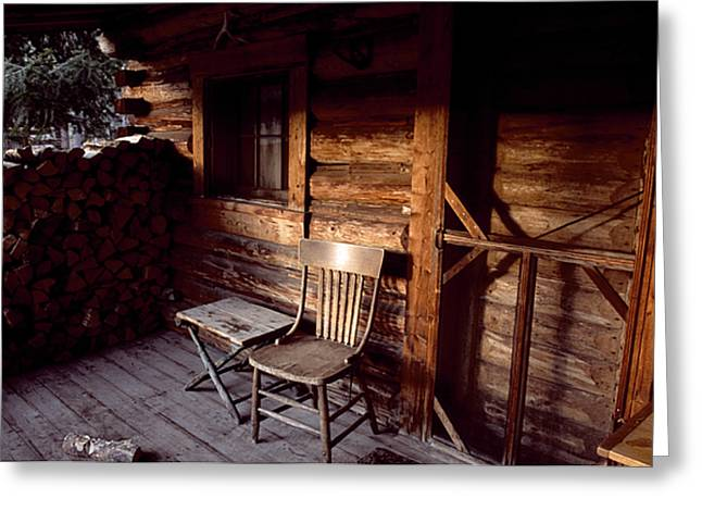 Hunting Cabin Greeting Cards - Firewood And A Chair On The Porch Greeting Card by Joel Sartore