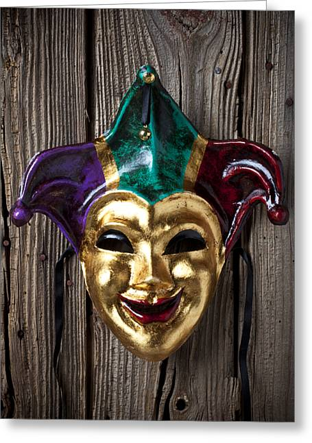 Disguise Greeting Cards - Jester mask hanging on wooden wall Greeting Card by Garry Gay