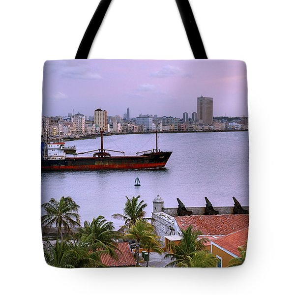 Cuba. Cargo Ship Leaving Havana Bay. Tote Bag by Juan Carlos Ferro Duque