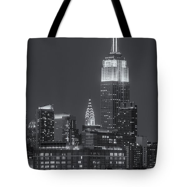 Empire State And Chrysler Buildings At Twilight II Tote Bag by Clarence Holmes