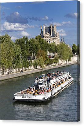 Sightseeing Boat On River Seine To Louvre Museum. Paris Canvas Print by Bernard Jaubert