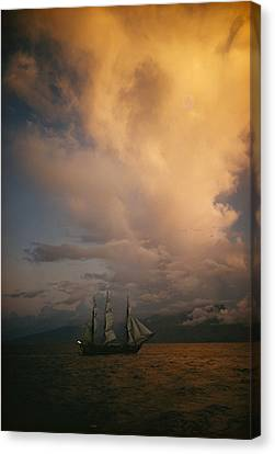 A Tall Ship, Sails Full Of Wind, Passes Canvas Print by Luis Marden