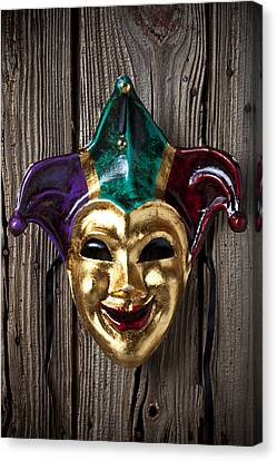 Jester Mask Hanging On Wooden Wall Canvas Print by Garry Gay