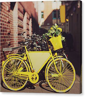 Yellow Bike Canvas Print by Julia Davila-Lampe