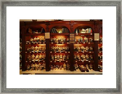 A Display Of Tea In A Tea Shop Framed Print by Richard Nowitz